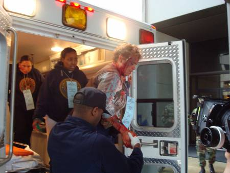 3 more victims leaving ambulance.  Photo - Cindy Love/NLM