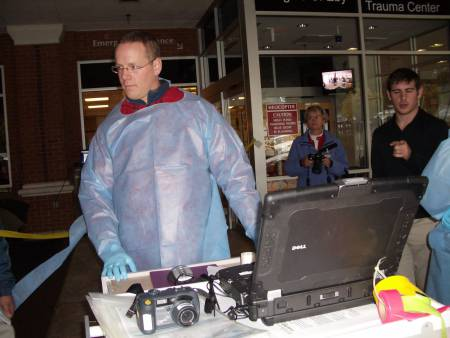 Disaster reported! Triage station setup, with forms, laptop having TriagePic software, camera.  Photo - Lan Le/NLM