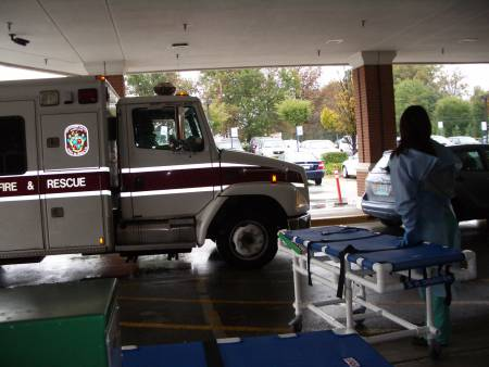 Rockville, Maryland ambulance arrives with first victims.  Photo - Lan Le/NLM